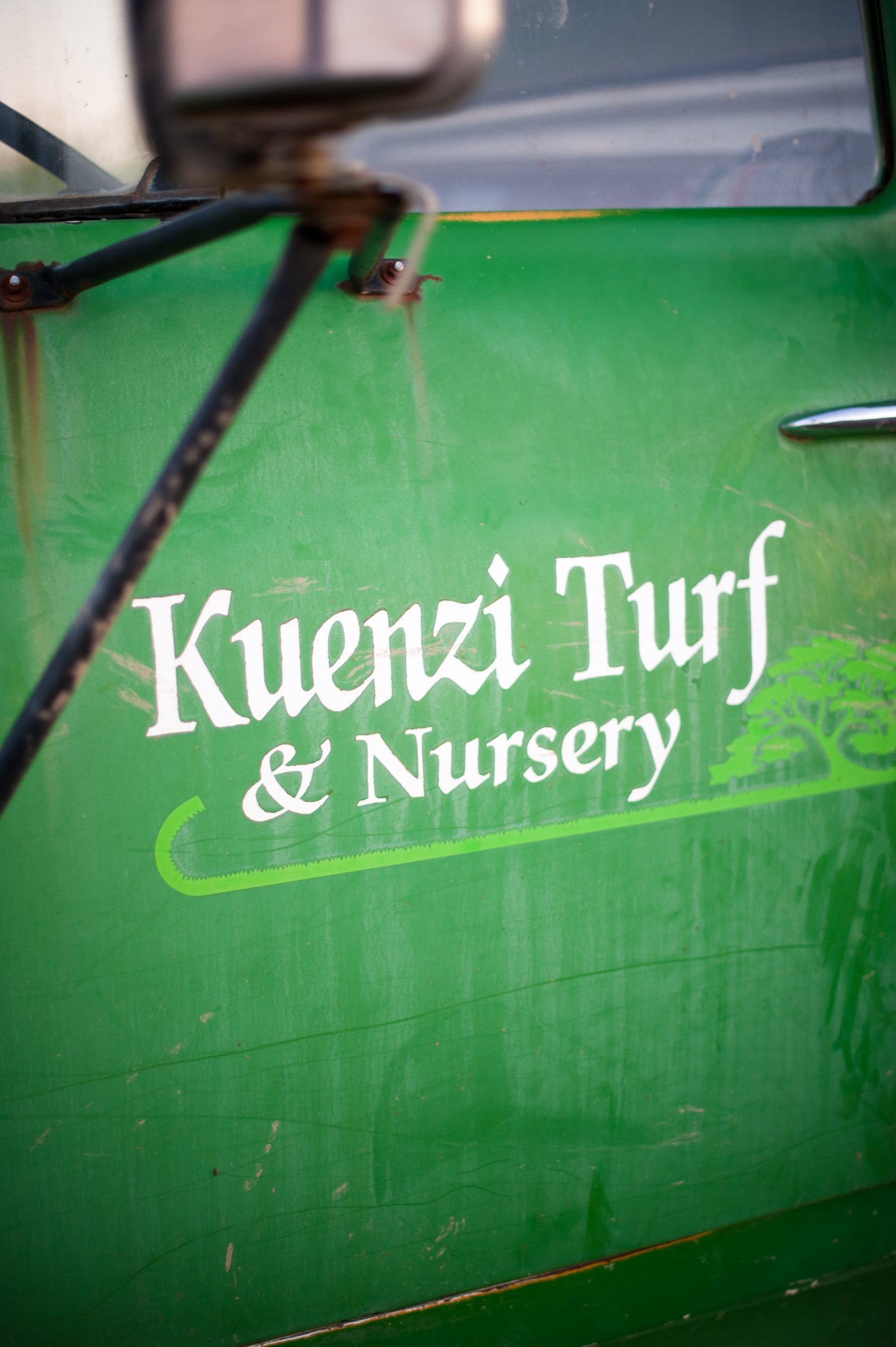 close up of Kuenzi truck that is used for sod sales